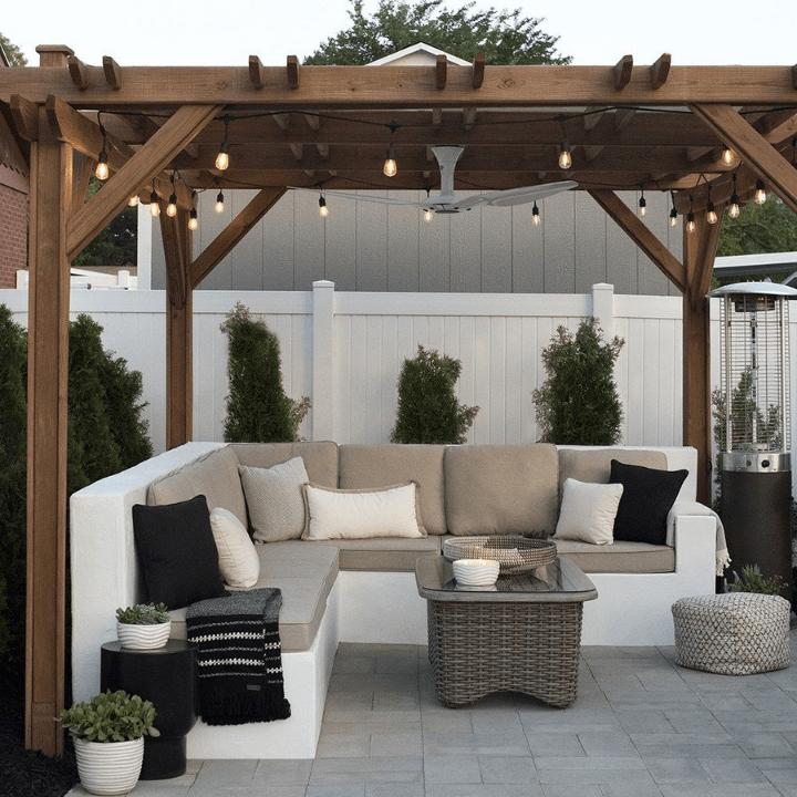 terrazas con sombra: pérgola en madera de acacia y conjunto sofá para terraza