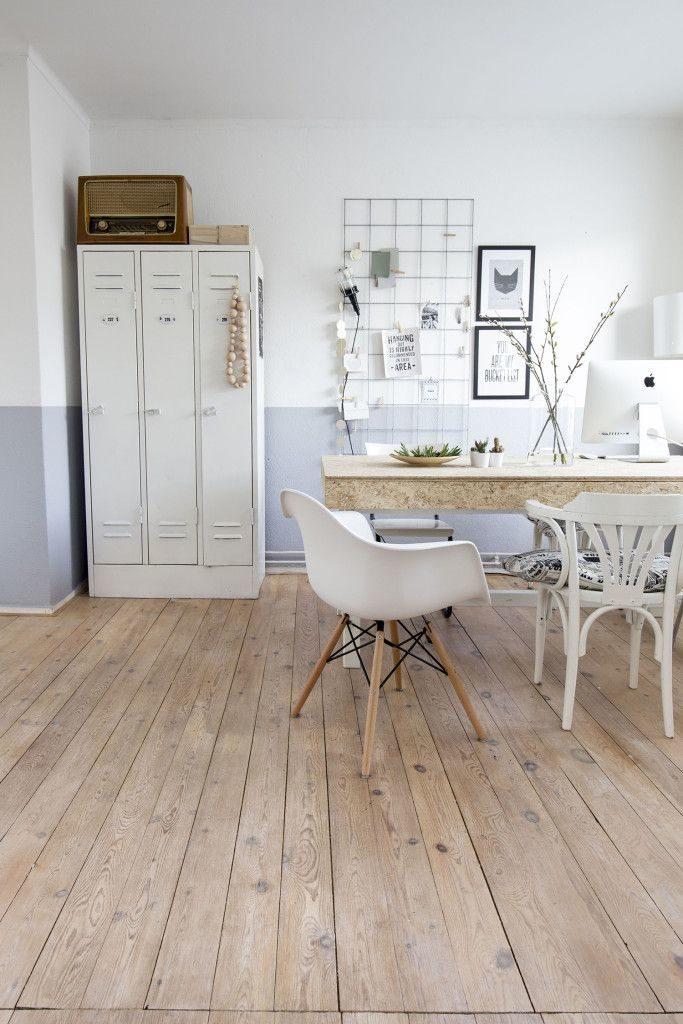 Zona de trabajo estilo nórdico con taquillas para almacenar
