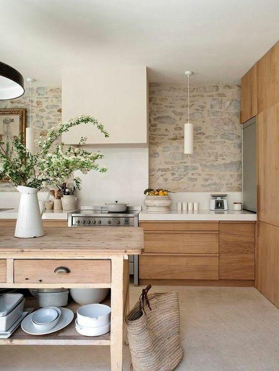 Cocinas de estilo rústico con paredes de piedra
